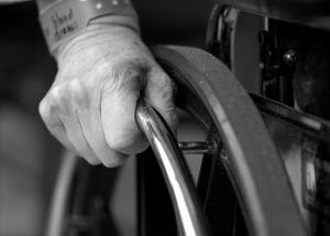 older hand on wheelchair tampa nursing home abuse attorney